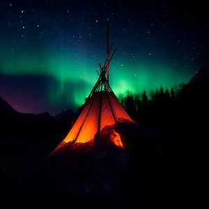 Aurora with Laavo teepee silhouetted in foreground
