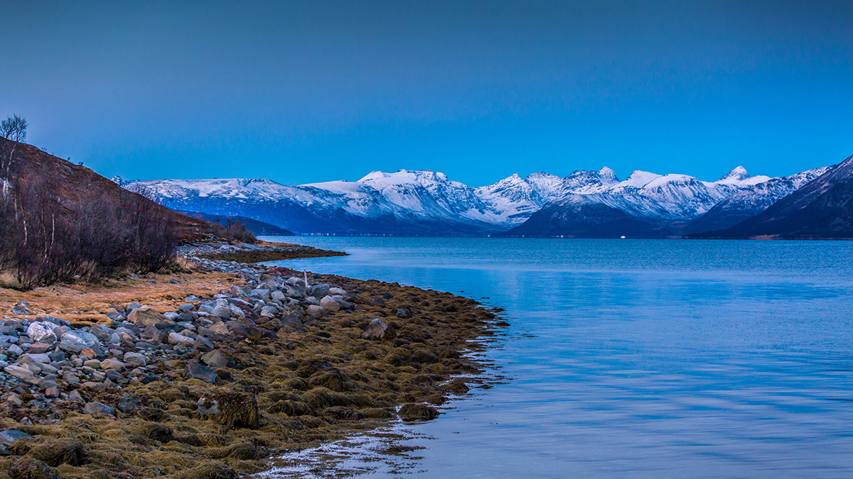 Deep blue fjords and snow covered mountains. Photo: Erwin Pietz