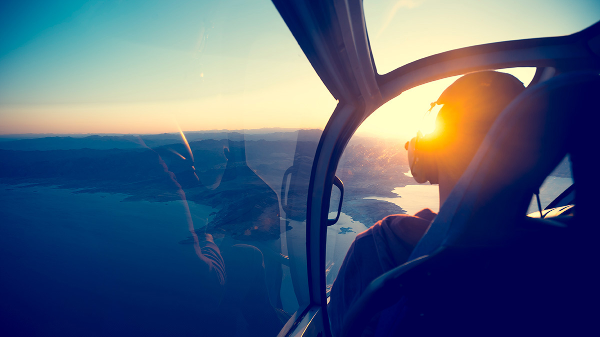 Helicopter on scenic flight at sunrise
