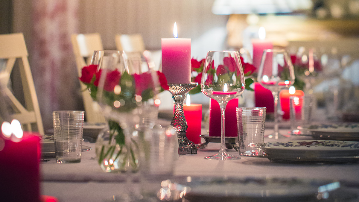 Photo of romantic dining table with candles