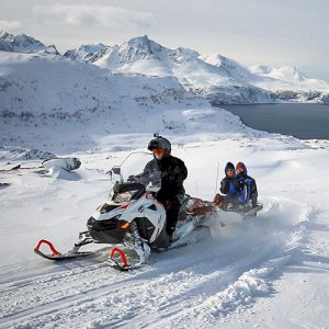 Daytime snowmobiling at Arctic Panorama Lodge