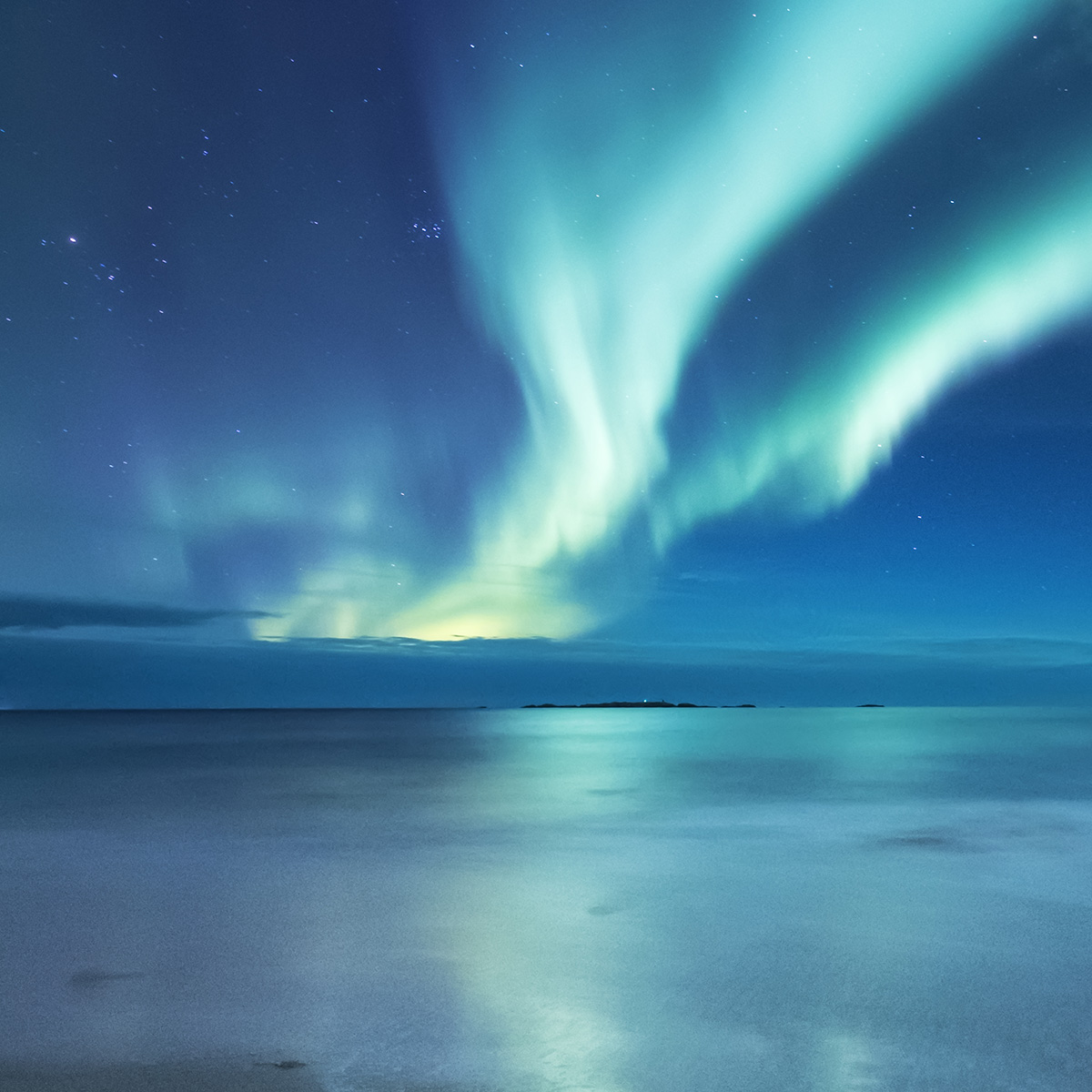 Sea with northern lights sky reflection